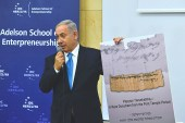 "Netanyahu holding up photo of the recently discovered ""Jerusalem"" papyrus."