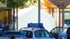 Police cars outside refugee shelter in Hamburg