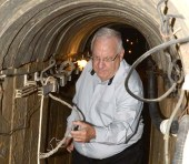 President Reuven Rivlin walking through Hamas terror tunnel dug into Southern Israel during his visit August 23, 2016.