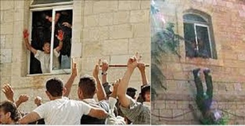 Arab Murderer showing his bloody hands to the crowd out the window of the Ramallah police station where Israeli soldiers were lynched in October 2000