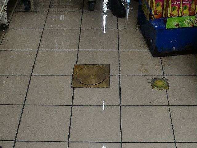 A Jerusalem supermarket is flooded by a winter storm.