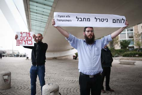 """Supporters of the Israeli soldier under arrest for shooting and killing an Arab terrorist on the ground in Hebron. The sign reads: """"Fighter neutralized terrorist."""""""
