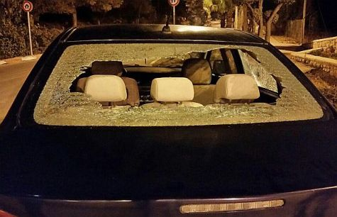 Back windshield smashed in Arab terror stoning attack.