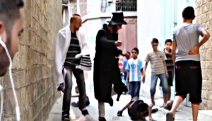 black hat kicking arab boy