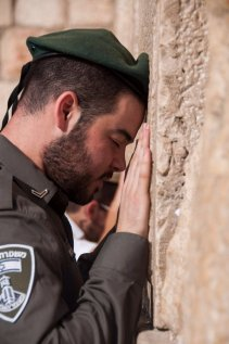 Border Guard Police Officer Raz Bibi offers a prayer of thanks for his life being saved, at the Western Wall.
