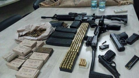 Large cache of weapons and ammunition confiscated by Palestinian Authority special security forces after raiding a house in a village near Jenin.