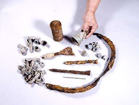 The finds that were discovered: metal fishhooks, dozens of lead weights, a large bronze bell.