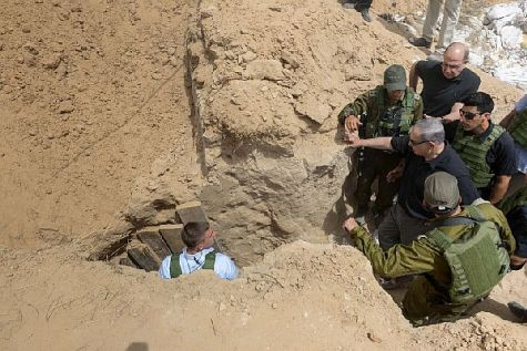Prime Minister Benjamin Netanyahu inspects a terror tunnel leading from Gaza under the border deep into Israeli territory.