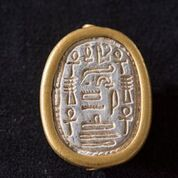 The writing on the scarab seal provides important information about its owner.