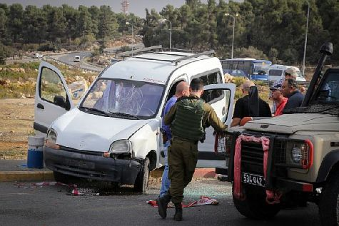 Israeli security forces at the site of a terror attack near the Gush Etzion junction where a Palestinian Arab man tried to run down pedestrians at a bus stop. He then left his car and tried to stab them.