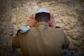 An Israeli soldier prays at the Western Wall, Judaism's holiest prayer site in the Old City of Jerusalem, September 15, 2016.
