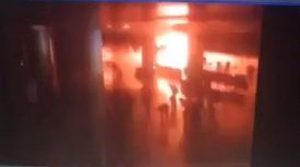 Surveillance video shows the moment the suicide bomber detonated the explosives vest at the airport.