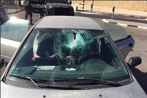 "A huge rock was thrown through the windshield of this car by ""masked Arab Palestinians"""