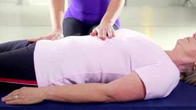 stock-footage-portrait-of-young-woman-working-as-spirit-healer-doing-reiki-therapy-and-smiling-looking-at