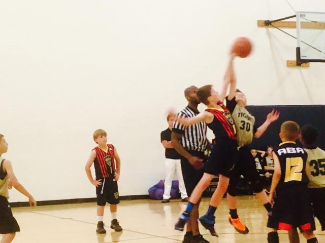 My son getting the jump ball. His team won the tournament, I ate a lot of junk.