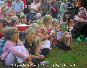 Children watch a Punch and Judy Show