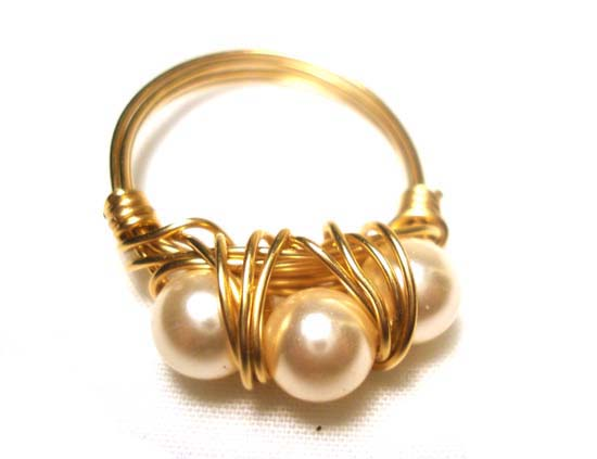 Gold wire wrapped ring with swarovski pearls