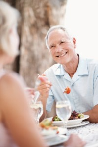 Man smiling at his wife while dining at Judson Meadows assisted living