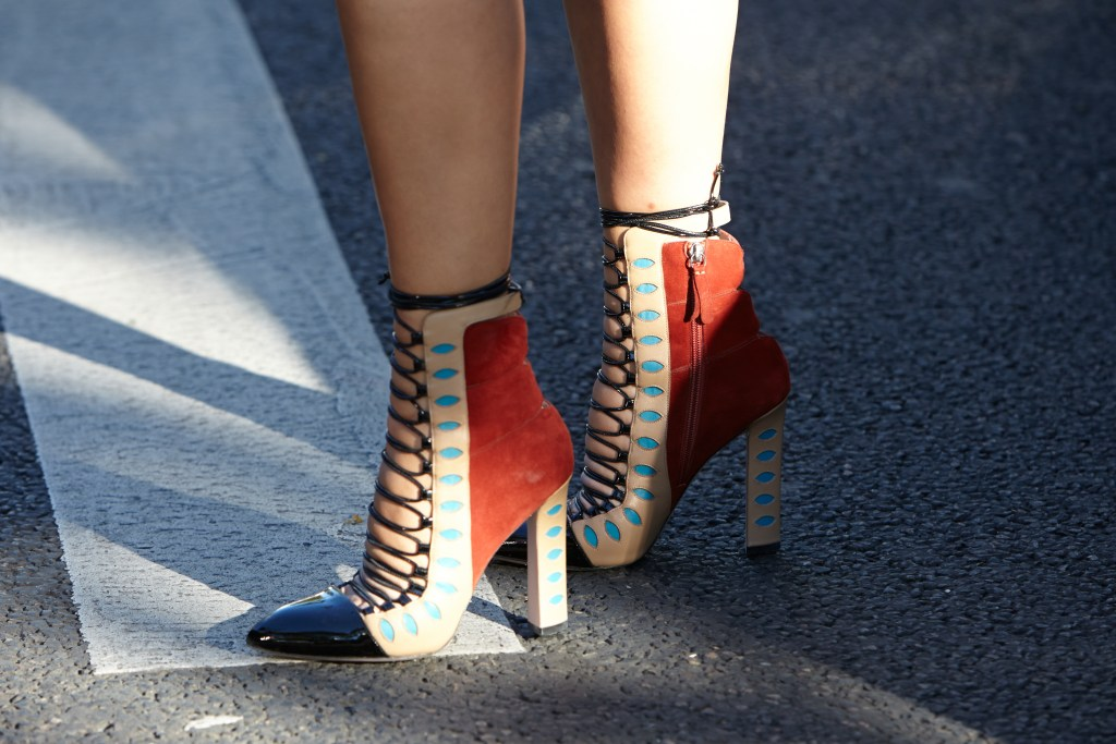 Laced heels from PFW. Fashionista wearing heels and waiting for show