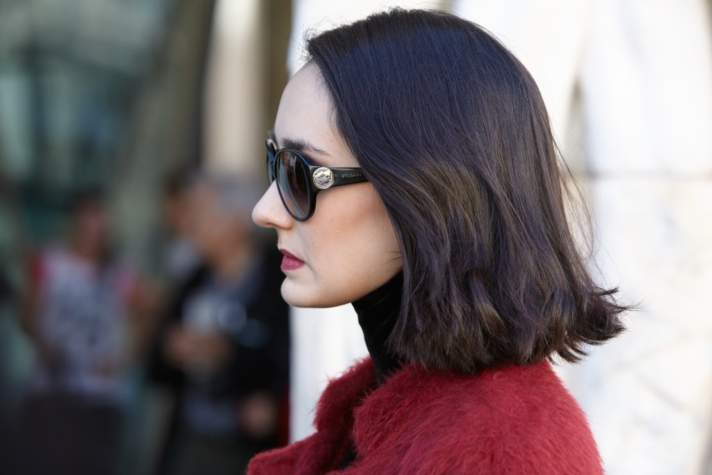 Sunglasses and red textured jacket from PFW