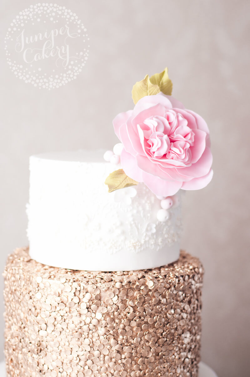 Lace and gold sequin wedding cake with Wildeve David Austen rose by Juniper Cakery