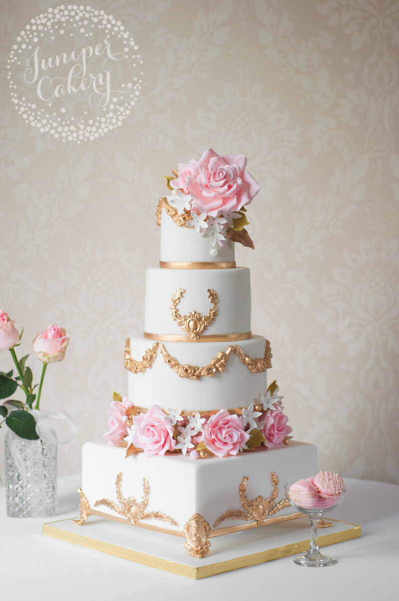 24k gold painted wedding cake by Juniper Cakery