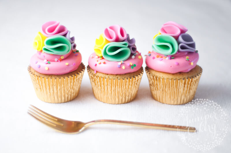 Rainbow pom pom cupcakes tutorial for parties by Juniper Cakery