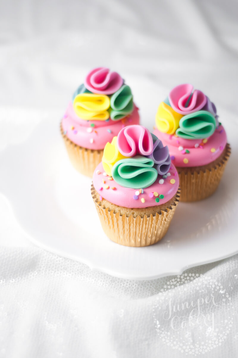Cute rainbow cupcakes by Juniper Cakery