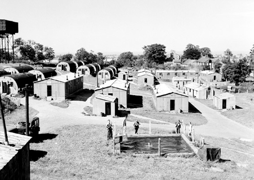 Part of the Skipton-on-Swale Air Base facilities, in Yorkshire, where No 424 and No 433 Squadrons were stationed. The Nissen huts with their curved, corrugated iron roofs were used as lodging quarters, August 10th, 1945.