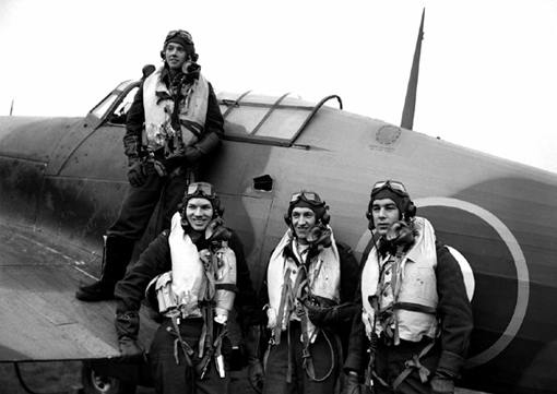 Four pilots of 438 Squadron in 1943: P/O R.E. Johnson on the wing and, from left to right, F/O R.F. Reid, F/O H.E. Dawber and F/O R.M. McKenzie. Johnson and McKenzie were killed in action on July 15th, 1944, and July 18th, 1944.