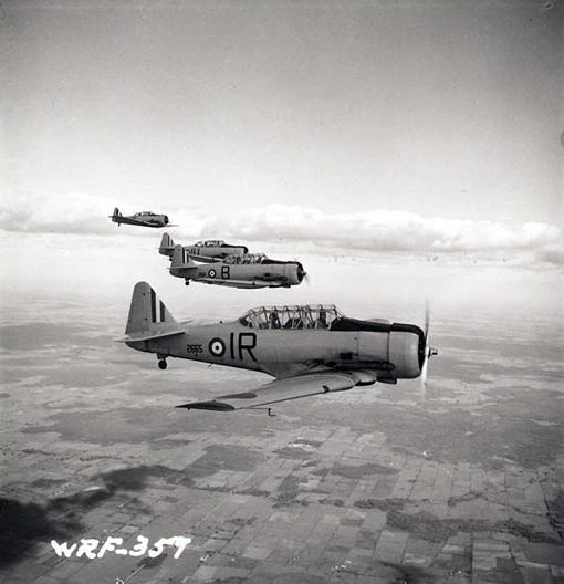 Four North American Harvard flying in formation near No 2 Service Flying Training School, Ottawa, July 1941.