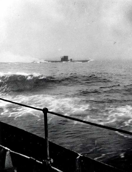 German U-boat U-210 from HMCS Assiniboine during attack that let to its sinking 6 August 1942.