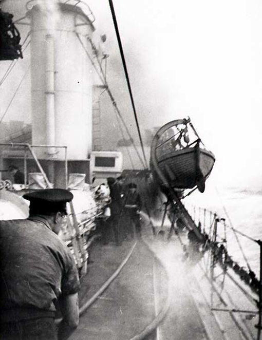 On the starboard side, a fire caused by enemy guns threatens the bridge from which Stubbs and his officers direct the combat.