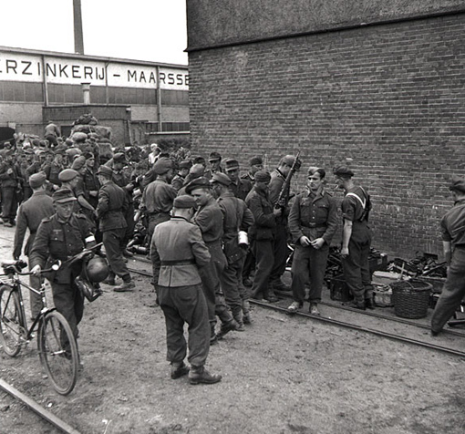 German soldiers being disarmed by troops of I Canadian Corps at a small arms dump in the Netherlands, May 11th, 1945.