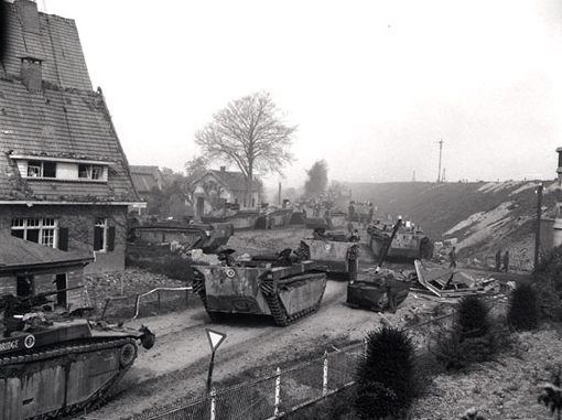 Loading carriers into Buffaloes, and Buffaloes moving towards Ijssel River near Westervoort, The Netherlands, April 13th, 1945.