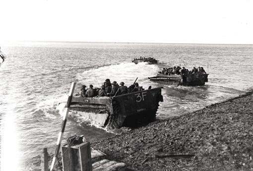 Buffalo amphibious vehicles carrying troops across the Scheldt to Hoofdplaat, October 13th, 1944.