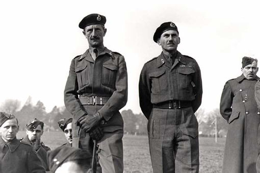 Major-General George Kitching (left) and Lieutenant-General Guy Simonds (right) listening to Marshal Bernard Montgomery addressing the troops of II Canadian Corps in Coptherne (England), February 29th, 1944.