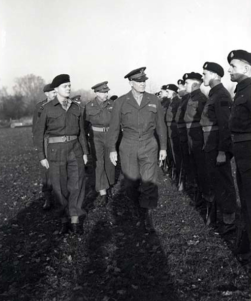 Followed by General H.D.G. Crerar, General Dwight D. Eisenhower inspecting the guard of honour of the 4th Canadian Armoured Division in Hertogenbosch, the Netherlands, November 29th, 1944