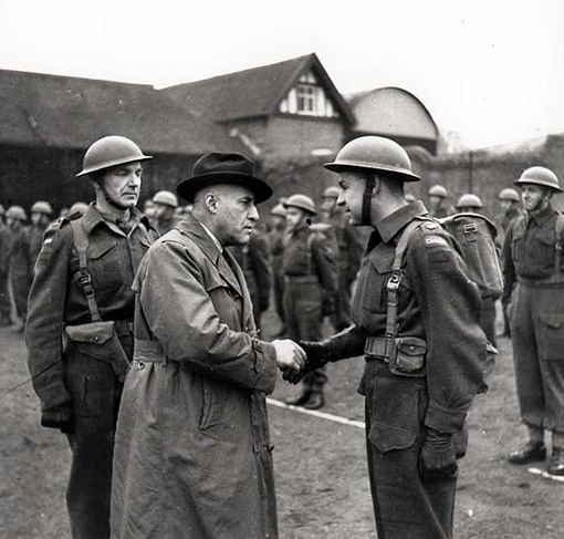 The Honourable J.L. Ralston inspecting Canadian troops stationed in England, December 1940