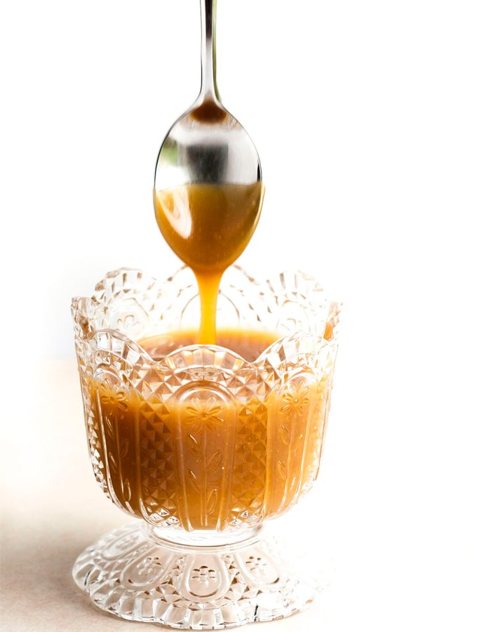 5 Minute Butterscotch Sauce - Once you make this sauce you'll never go back to store-bought again. It's so good and so easy! | justalittlebitofbacon.com