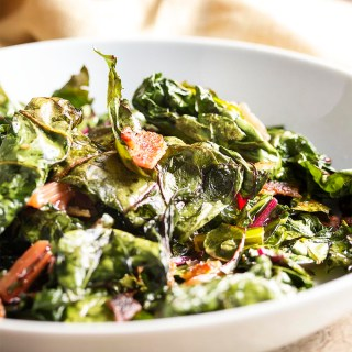 Swiss Chard Chips - Don't know what to do with chard? Family won't eat it? Try this recipe where Swiss chard leaves are tossed in bacon fat and baked to crispness to make addictively yummy chard chips. | justalittlebitofbacon.com
