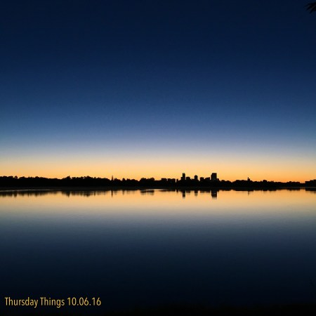 View of the Denver skyline during a sunrise speed workout around Sloans Lake.