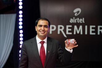 Airtel Kenya CEO Adil El Youssefi Displays Airtel Money Premier VISA Card