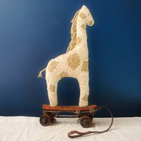 Our giraffe is hooked with an assortment of wools and organic cottons.  Stuffed with organic cotton, too.