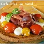 Recette des tartelettes du soleil pour une entrée avec des tomates cerises et du jambon de pays
