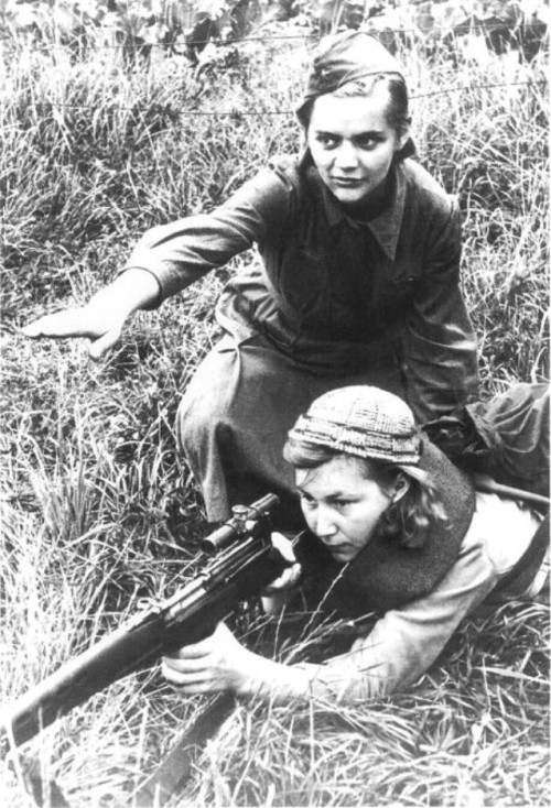 Female Soviet Sniper training a Partisan Fighter on the Eastern Front. WW2.