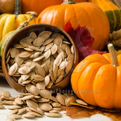 Stock Image: Orange Pumpkins With Toasted Pumpkin Seeds