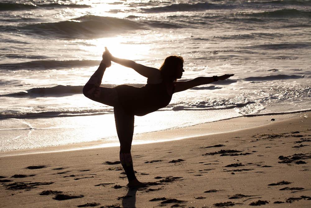 Early Morning Yoga On The Beach