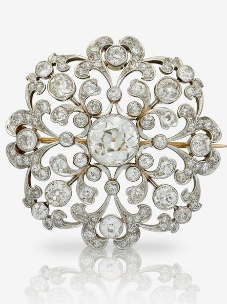 An Edwardian diamond and platinum-topped eighteen karat gold brooch, Marcus & Co., circa 1910