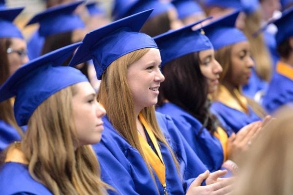 Photo credit: Frank Posillico | Maggie Corrigan, 18, was among the 515 graduates of Kellenberg Memorial High School. Her fellow students and teachers held a fundraiser for her family after their home burned down in 2011. (June 2, 2013)
